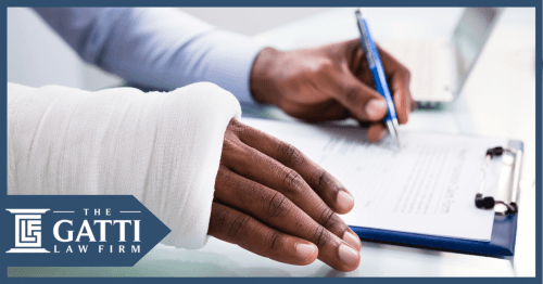 injured man signing insurance papers